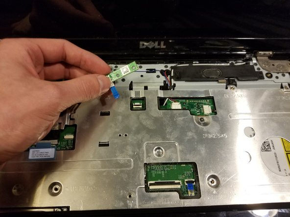 Pry the power button board out with your finger.