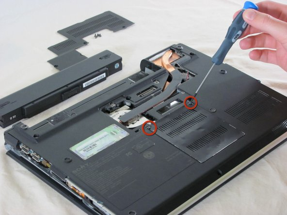 Unscrew the two memory panel screws and set the panel aside.