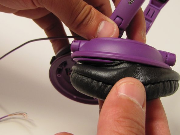 Separate the padding from your ear-cup by pulling at the padding where it meets the plastic of the ear-cup. Pull gently and do this along the entire circumference of the headphone ear-cup.
