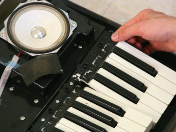 Remove the block of keys that holds the key you wish to install.