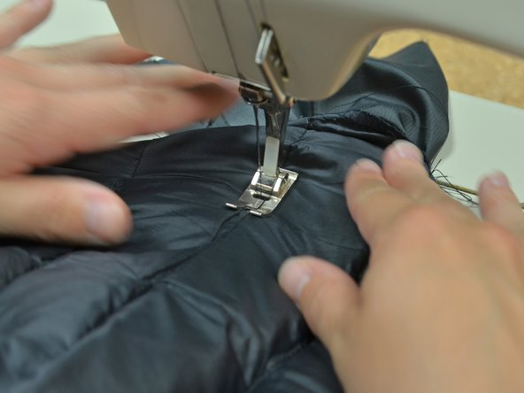 Sew directly over the original middle baffle stitching between the two seams you just made.