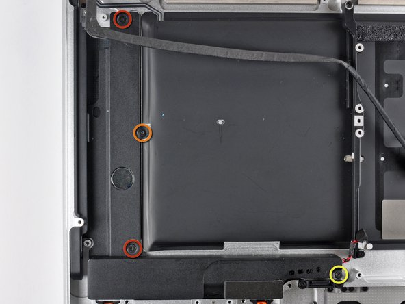 Remove the following four screws securing the subwoofer and right speaker assembly to the upper case: