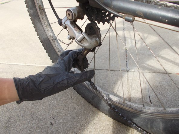 If Step 2 is not enough, push rear derailleur forward to release tension on the chain.