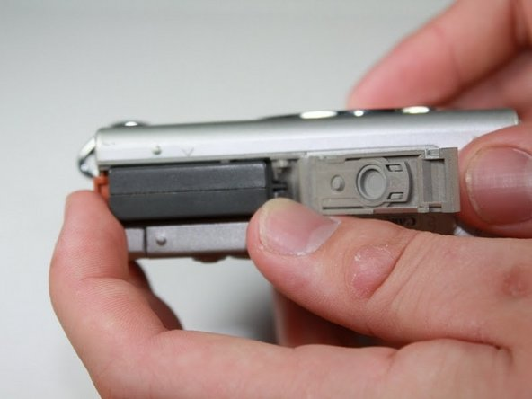 Grasp battery and fully pull out of slot