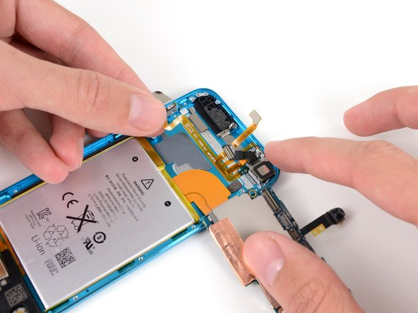 Our next step is to peel the volume buttons/microphone/LED flash/power button ribbon cable assembly from the rear case.
