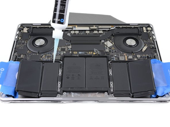 Apply a few drops of adhesive remover under each of the remaining three battery cells.