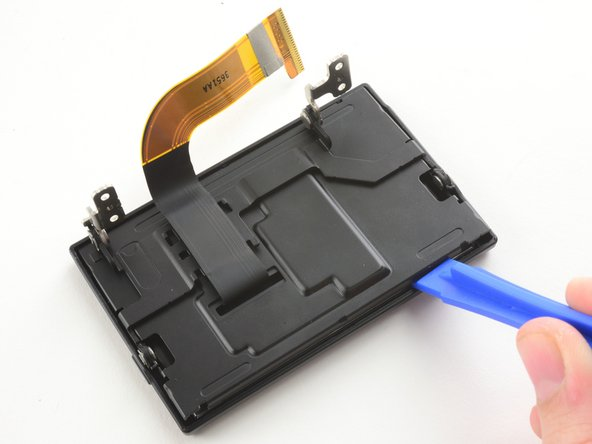 Use a plastic opening tool to pry the LCD case open.