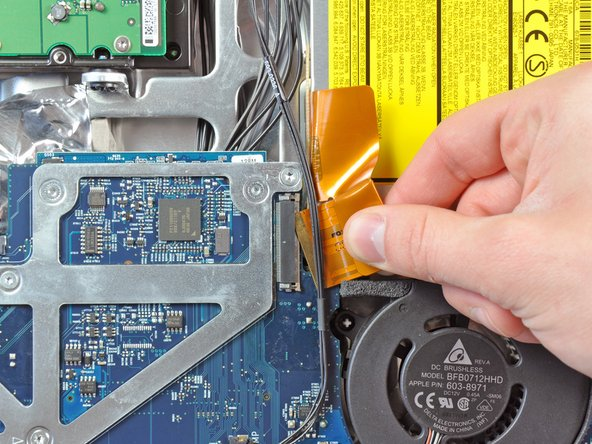 Pull the optical drive ribbon cable out of its socket, being careful not to rip it in the process.