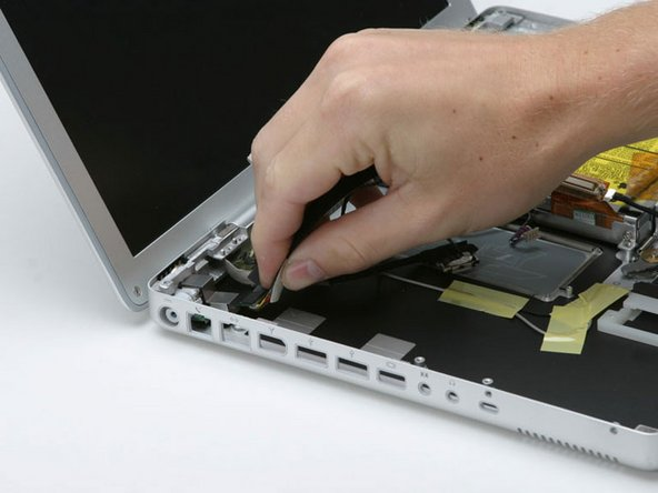 Pull the flat, black DC power cable up from the bottom of the case, removing tape as necessary.