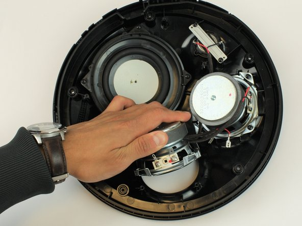 Pull out the speaker, and if necessary follow these steps to replace the other identical speaker.
