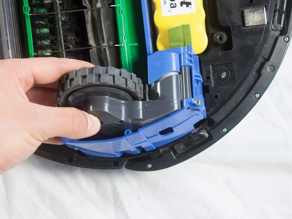Gently lift the wheel to remove.
