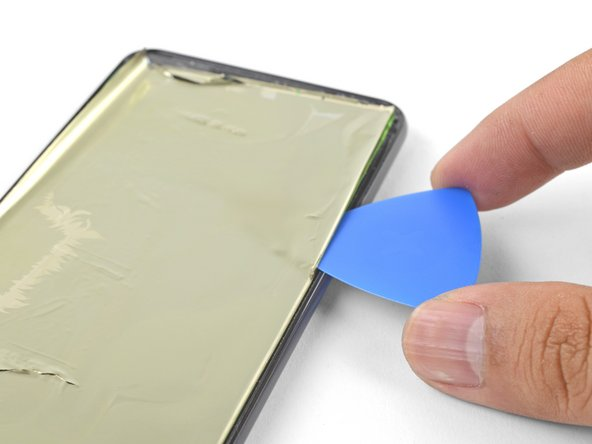 Continue applying heat and slicing along a screen edge until you've loosened enough material to be grasped with your fingers.
