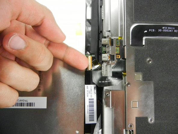 Lift the retaining flap on the ZIF connector of the upper flex cable.