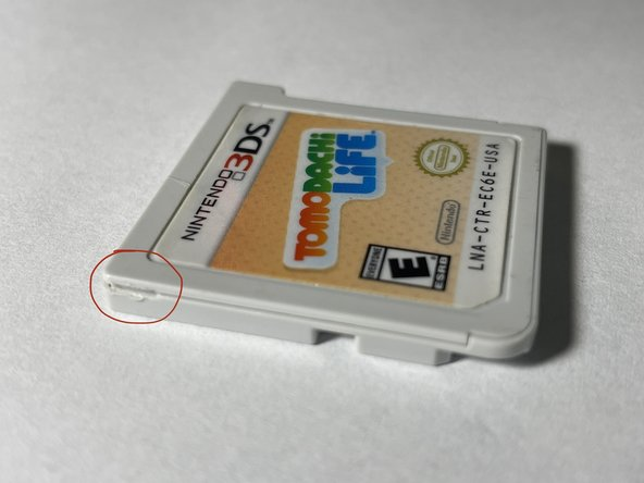 Find the tab on the left side of the cartridge.