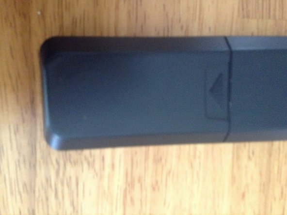 On the back of the remote there will be a battery cover. Open it up.
