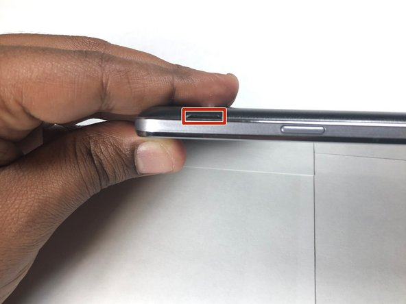 Locate the side notch that allows you to open the back casing.