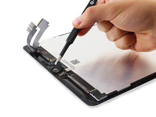 Remove the Home Button bracket and peel up the tape connected to it.
