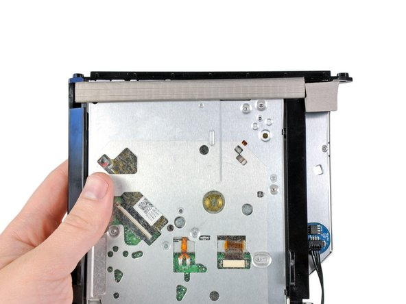 Peel the long strip of EMI foam from the underside of the optical drive.