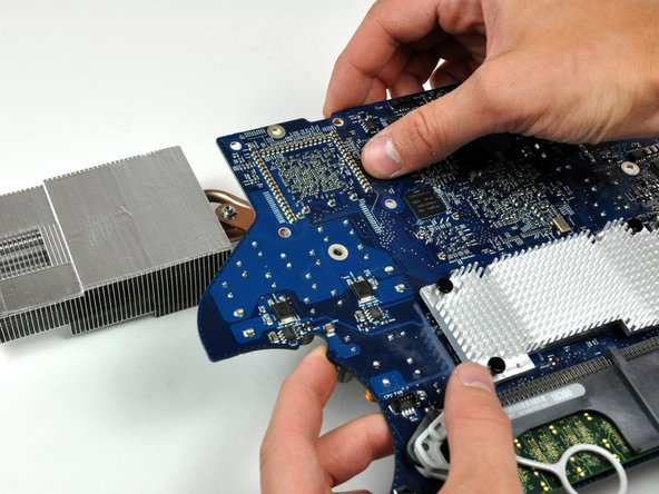 Lift the logic board up off the heat sink.