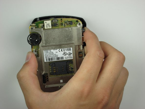 With one side loosened, simply lift the phone internals to separate from the front casing.
