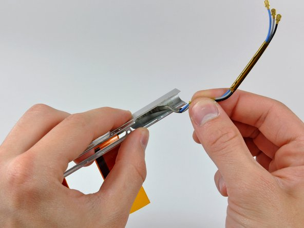 If necessary, peel the antenna leads off the adhesive securing them to the clutch cover.