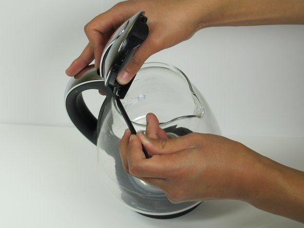 Adhesive tape is left holding the lid to the glass pot.