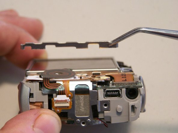 Remove the one quarter bracket around the LCD screen