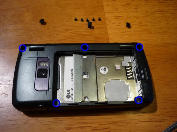 Remove 5 small black screws from the back cover. I used a #00 Philips screwdriver, but a #0 should also work as well.