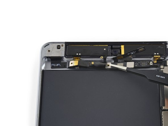 Gently fold the headphone jack ribbon cable back to reveal the antenna interconnect cable under the left antenna.
