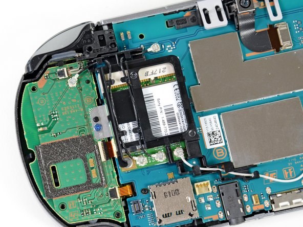 The wireless card is easily identifiable by the mess of antenna cables connected to it.