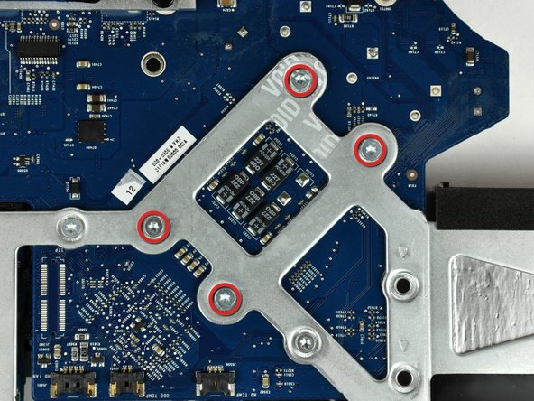 Remove the four fine-thread 5 mm T8 Torx screws securing the heat sink to the logic board.