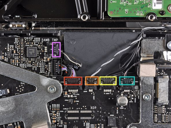 Disconnect the following cables by pulling their connectors toward the top edge of the iMac: