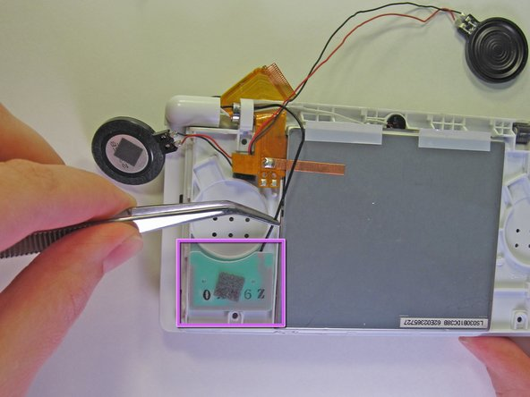Carefully use a pair of tweezers to remove the wireless antenna.