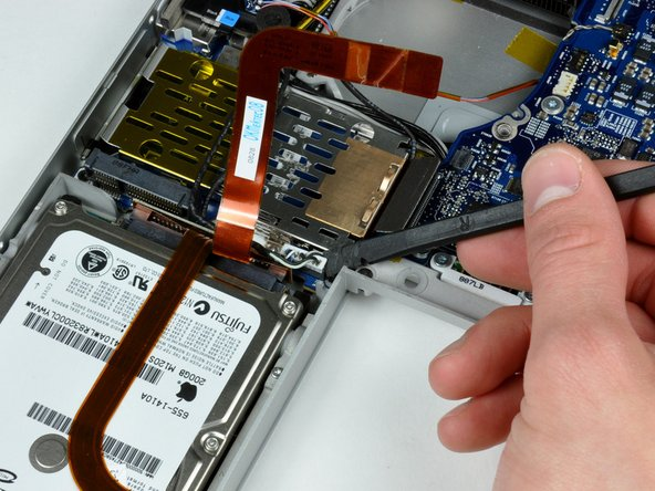Use a spudger to disconnect the speaker cable from the corner of the left I/O board.