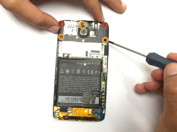 Remove the five screws at the top of the panel using a Phillips head screwdriver.