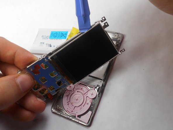 Use a plastic opening tool to remove the screen from metal back plate.