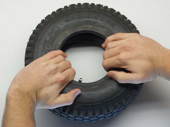Spread the replacement inner tube evenly against the walls of the tire.