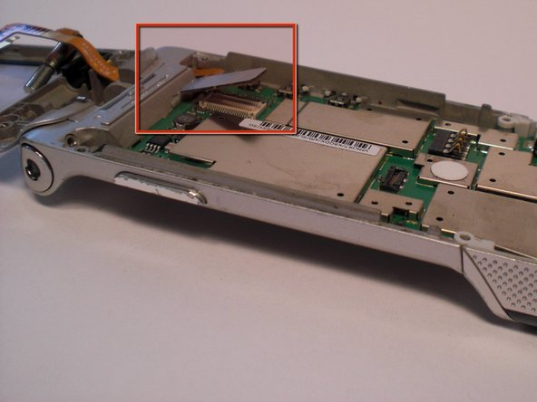 To remove the chip board, first unplug the flex cable from the logic board with tweezers.