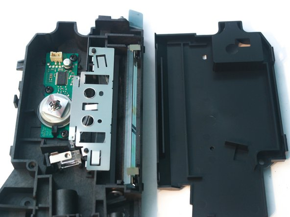 After removing the cover and the clips holding in the lenses, the inside of the laser assembly can be seen.