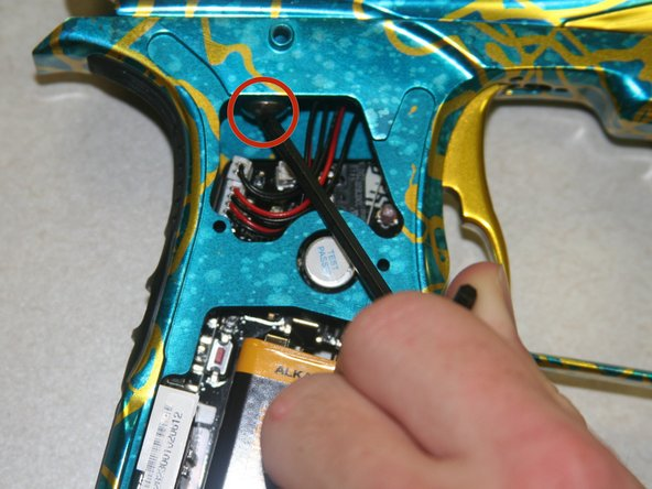 """Use 1/8"""" allen wrench to loosen the screw inside the grip on the right side."""