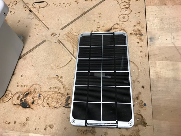 Obtain a solar panel with the appropriate metal plate.