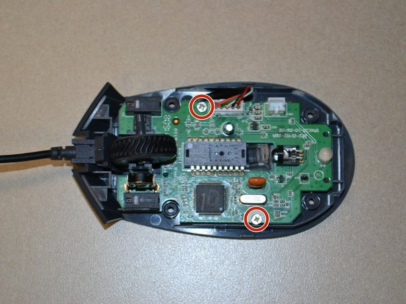 Use the JIS 0 screwdriver to remove the two 5mm screws on the motherboard.