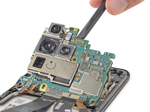 After we delicately yank the motherboard out, we make a beeline for the camera assemblies, where we're greeted by a familiar friend from the S20 Ultra, the 12 MP ultra-wide.
