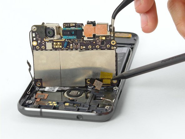 While holding the motherboard up with tweezers, use a spudger to disconnect the fingerprint sensor cable from the motherboard.