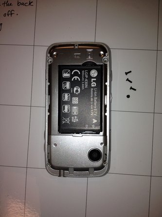 Remove the four black screws securing the corners of the phone using a small Phillips screwdriver.