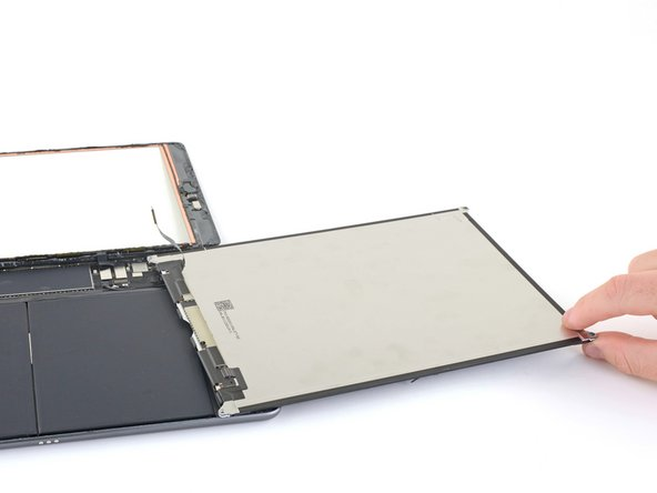 Remove the LCD completely and rest it face down on a clean, soft, lint-free surface.