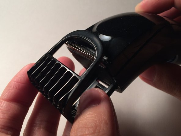 Remove the comb from the head of the trimmer.