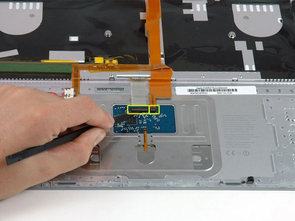 Use the tip of a spudger to flip up the black plastic flaps locking down the keyboard and keyboard backlight ribbon cables.