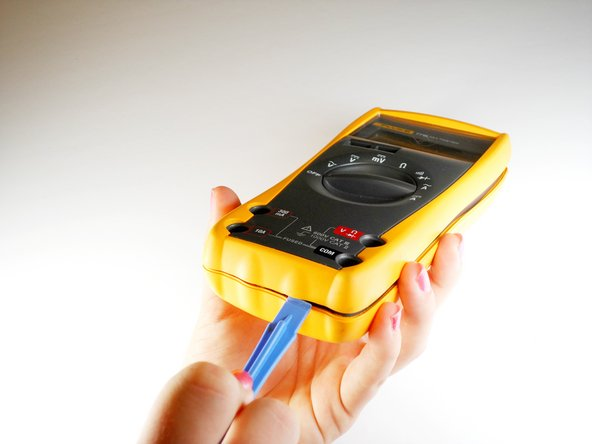 Turn the Fluke 77 Series III Multimeter back over so that it is display side up.
