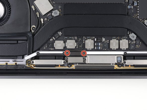 Remove the two 2.9 mm T3 Torx screws securing the aluminum cover on top of the main display cable.